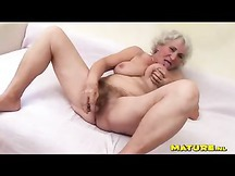 White haired granny has a hairy wet cunt she plays with